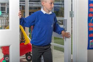 Image shows child with fingers in door and frame gap